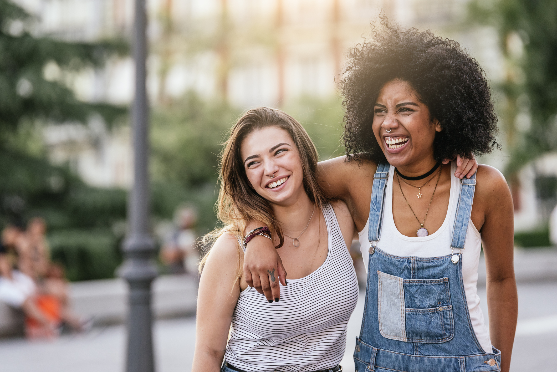 Beautiful women having fun in the street. Youth concept.