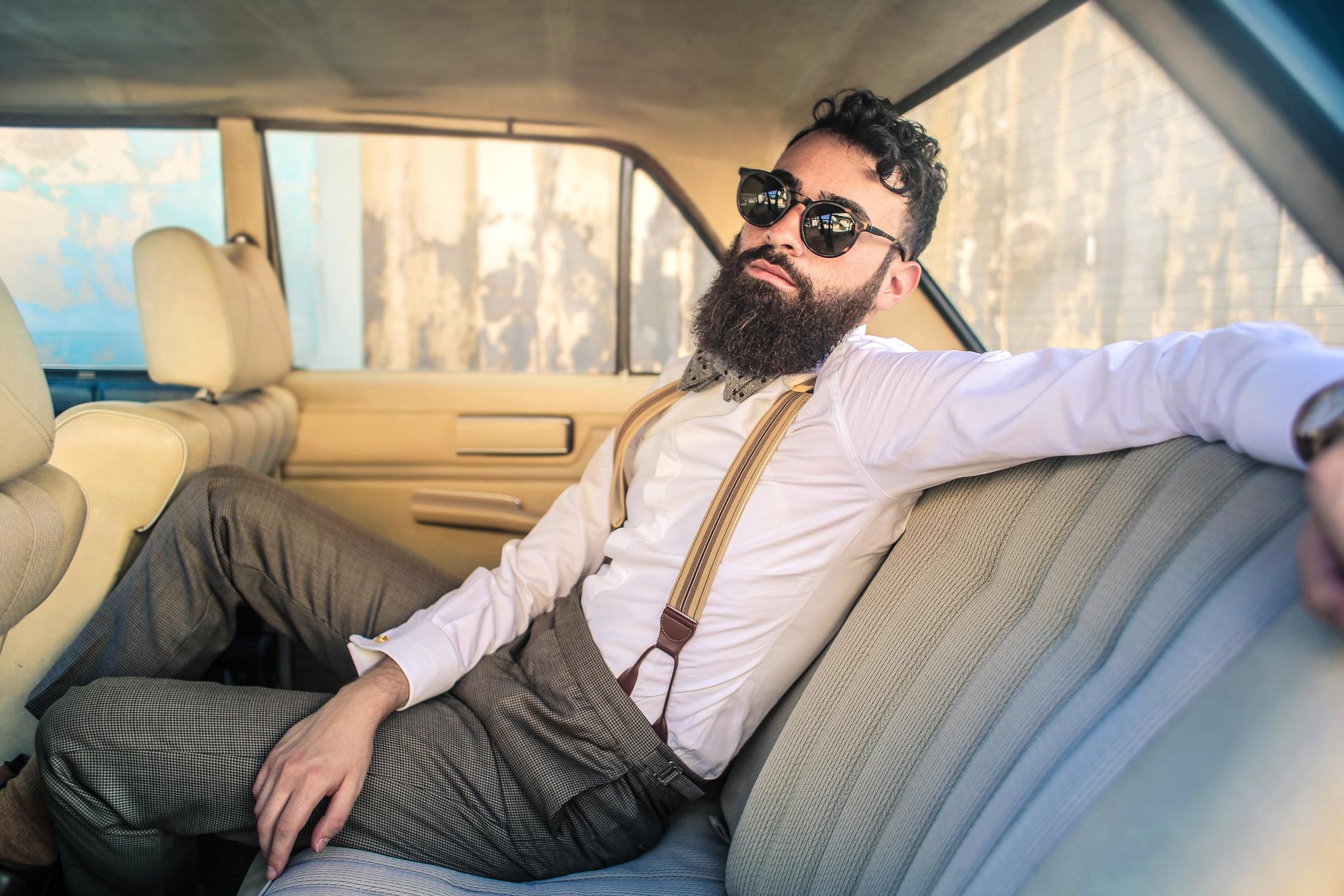 Man sitting in a vintage car