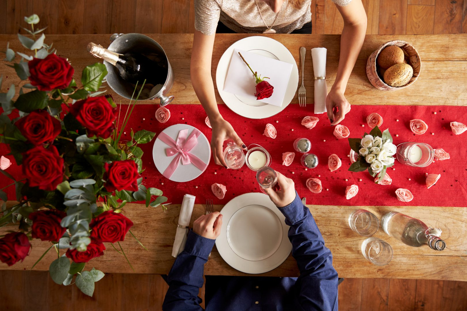 Overhead View Of Romantic Couple At Valentines Day Meal