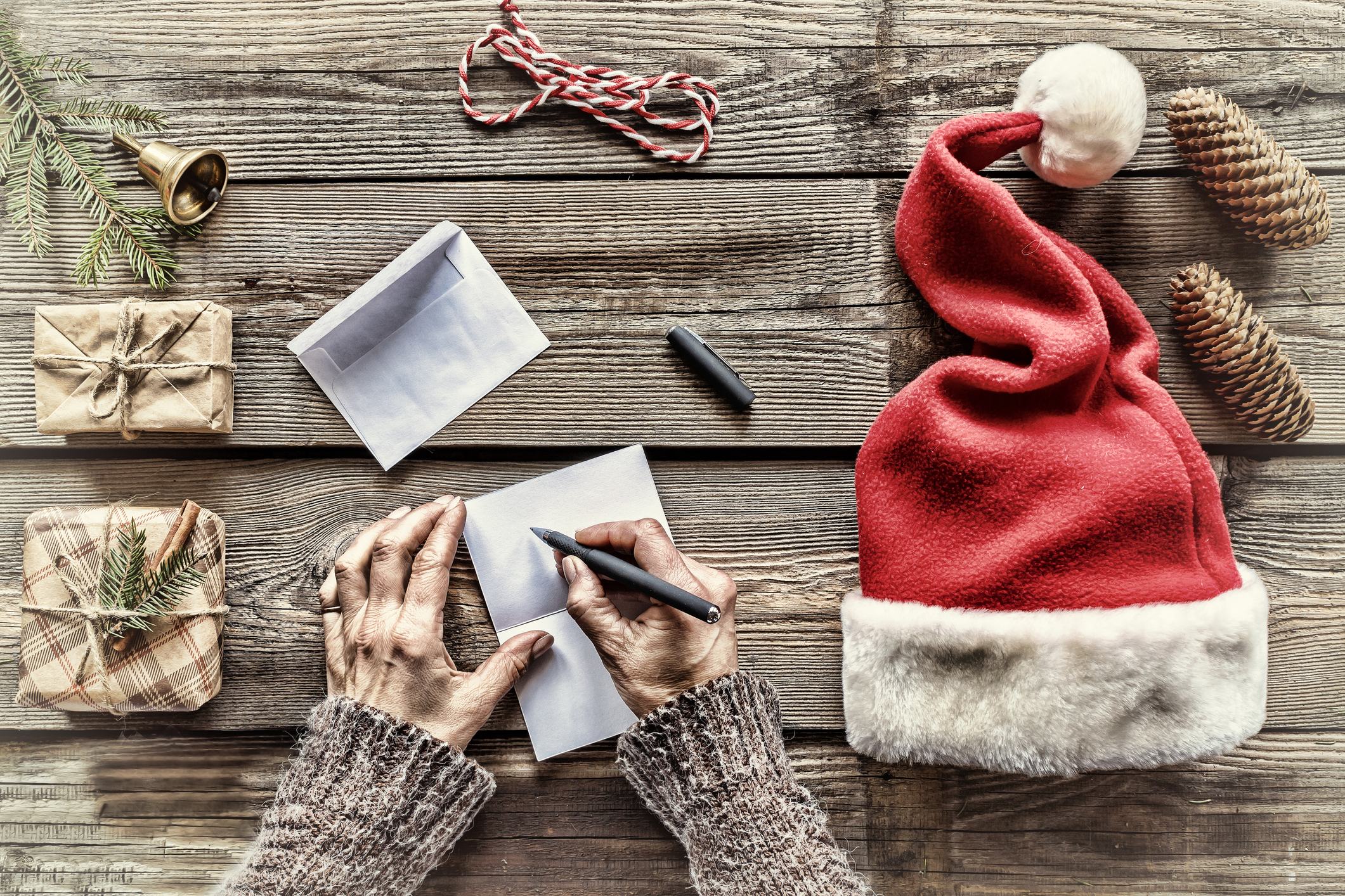 Conception: Christmas. Making Christmas gifts. A man writes a letter Greeting cards to family and friends