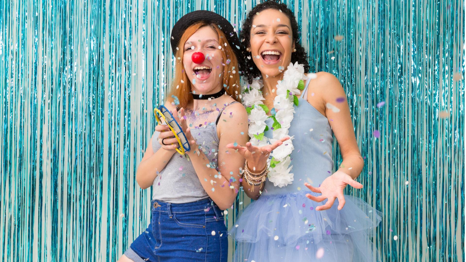 two-friends-are-celebrating-carnaval-blue-color-predominant-confettin-picture-id901980716