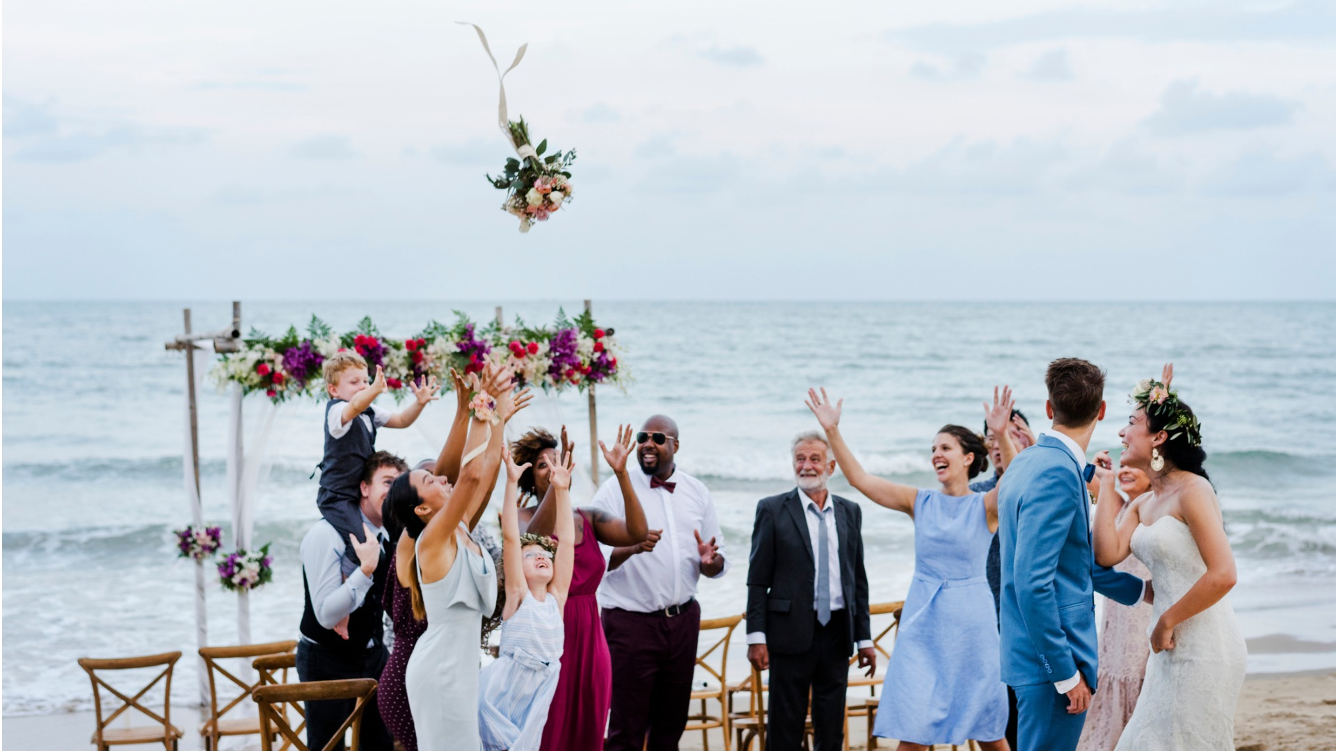 bride-throwing-the-bouquet-at-wedding-picture-id1040949944