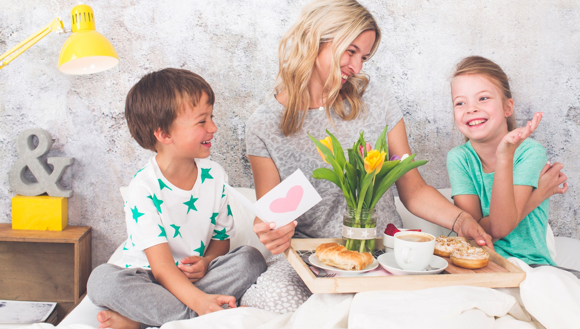 mothers-day-two-children-surprise-their-mother-with-breakfast-in-bed-picture-id946441468