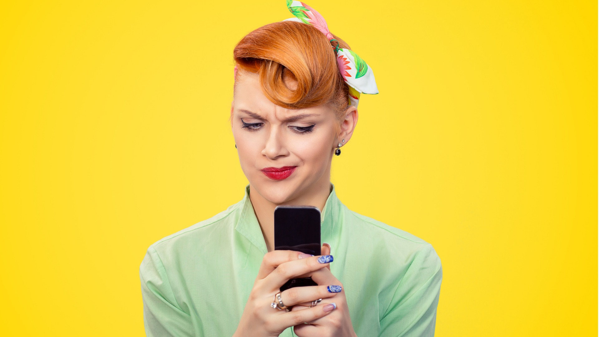 unhappy-serious-woman-looking-at-texting-on-phone-displeased-with-picture-id1035150660